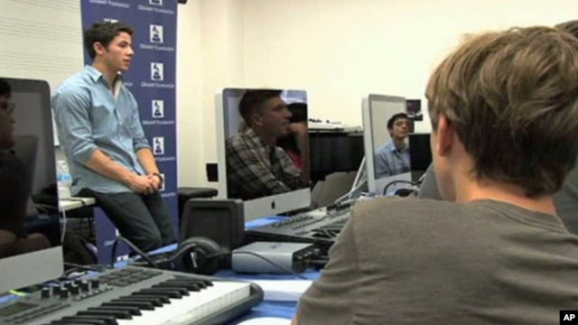 Aspiring young musicians attend a Los Angeles summer camp and get tips from music industry professionals