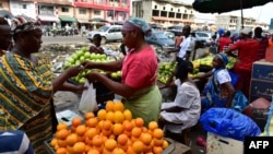 A vendor sells fruit at the large market of Adjame, a popular district of Abidjan, Ivory Coast, Aug. 10, 2017.