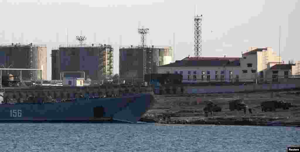 Trucks drive out of Russian landing craft Yamal 156 near the Crimean port of Sevastopol, March 14, 2014.