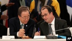 "French President Francois Hollande, right, speaks with UN Secretary-General Ban Ki-moon as they attend ""The Climate Challenge and African solutions"" event during the COP21, the UN Climate Change Conference, in Le Bourget, north of Paris, Dec. 1, 2015."