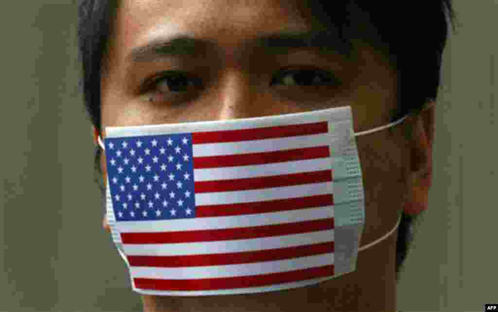 A supporter of WikiLeaks founder Julian Assange wears the mask featuring the American National flag during a protest at Consulate General of the United States in Hong Kong Friday. (Kin Cheung/AP)