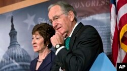 Sen. Tom Harkin, right, stands with Sen. Susan Collins just after the Senate cleared a major hurdle and agreed to proceed to debate a bill that would prohibit workplace discrimination against gay, bisexual and transgender Americans, at the Capitol in Washington, Nov. 4, 2013.