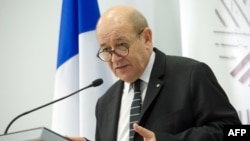 French Defense Minister Jean-Yves Le Drian gives a press conference following an Informal Meeting of EU Defense Ministers in Riga, Latvia, Feb. 19, 2015.
