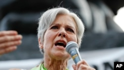 "FILE - A post on the website of Green Party presidential nominee Jill Stein calls voting machines used in Wisconsin ""highly vulnerable to hacking and malicious programming."""