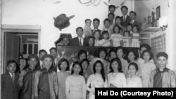 FILE - A family photo from the wedding of Hai Do's aunt, Pham Thi Nhung, center. Do's grandfather, Pham Dinh Lieu, is in front, at the far right. Do's mother, Pham Thi Loc, is to his right, in front. Hai Do is at the top of the photo, wearing glasses.
