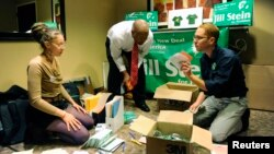 FILE - Campaign workers for presidential candidate Jill Stein sort campaign materials as delegates gather for the Green Party presidential nominating convention in Baltimore, Maryland, July 14, 2012.