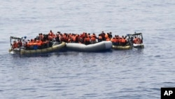 This undated image made available on May 30, 2016 by the Italian Navy Marina Militare shows migrants being rescued at sea. Survivor accounts have pushed to more than 700 the number of migrants feared dead in Mediterranean Sea shipwrecks over three days in the past week, even as rescue ships saved thousands of others in daring operations.