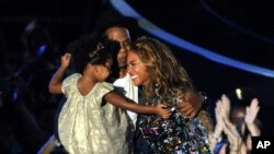 Beyonce, Jay Z and their daughter Blue Ivy. (Photo by Chris Pizzello/Invision/AP)
