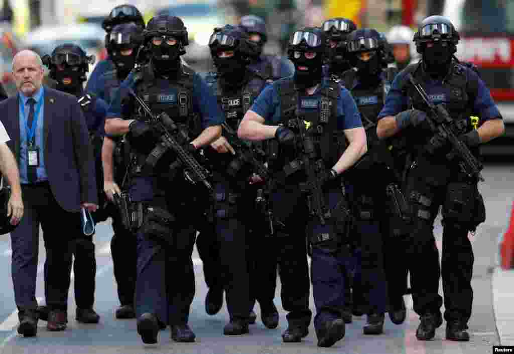 Armed police officers walk outside Borough Market after an attack left seven people dead and dozens injured in London, Britain.