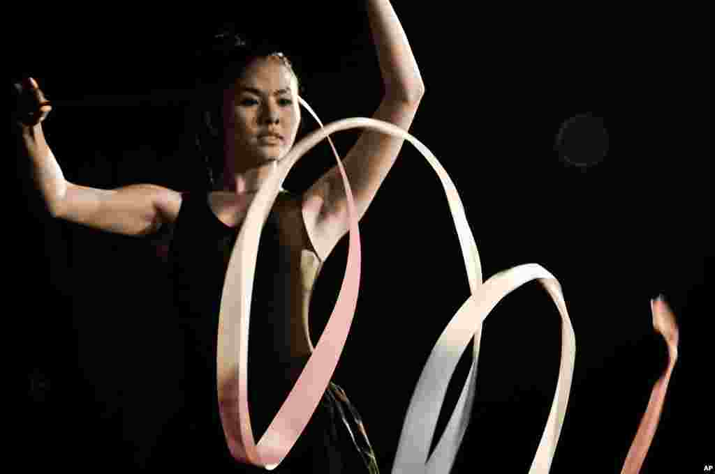 "Mai dancing with ribbons in the movie ""Saigon Electric"" (Courtesy of Saigon Electric)"