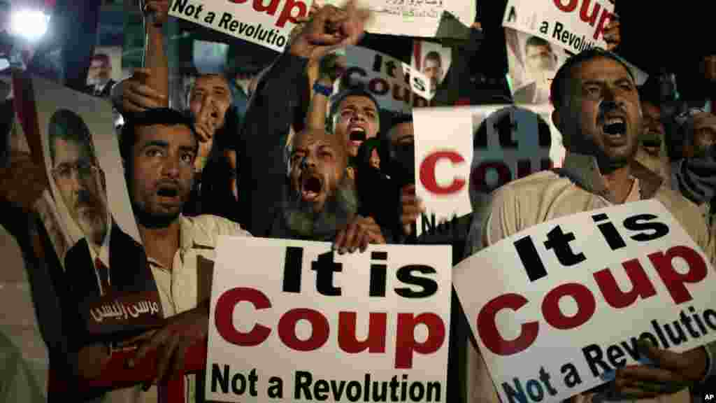 Supporters of Egypt's ousted President Mohamed Morsi pray at Nasr City, July 28, 2013.