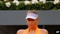 Maria Sharapova from Russia sits in a break during her Madrid Open tennis tournament match against Eugenie Bouchard from Canada, in Madrid, Spain, May 8, 2017. Bouchard won 7-5, 2-6 and 6-4.