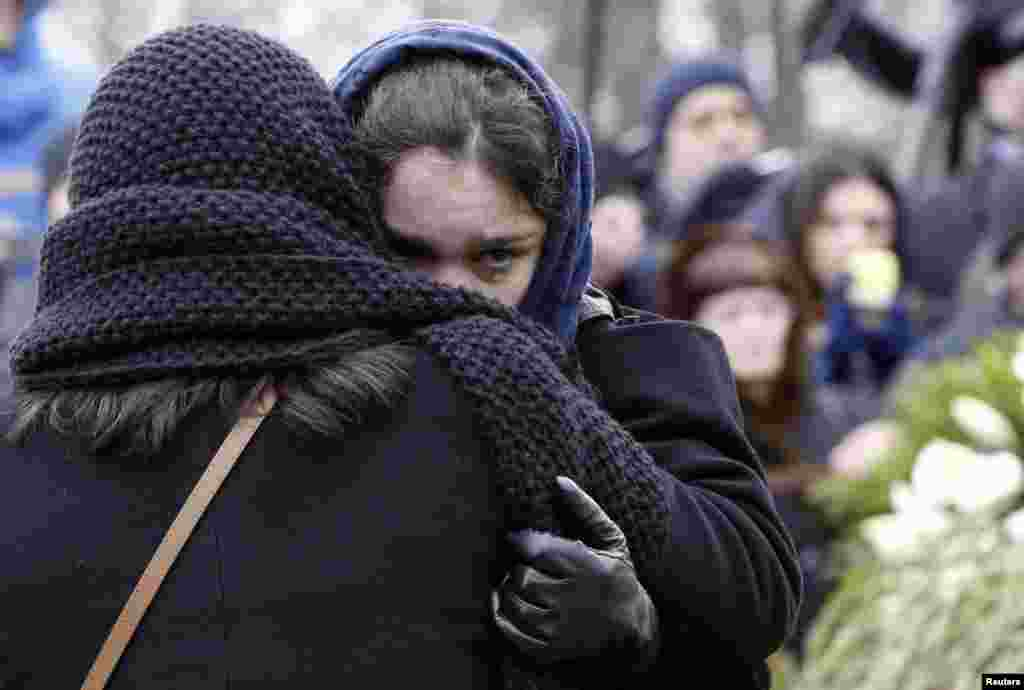 Zhanna, daughter of Russian leading opposition figure Boris Nemtsov, cries during his funeral in Moscow. Thousands of Russians, many carrying red carnations, queued to pay their respects to the Kremlin critic who was gunned down last week.