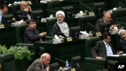 Iranian lawmakers attend an open session of parliament to choose the interim presiding board in Tehran, Iran, May 29, 2016. Iran's long-serving parliament speaker Ali Larijani will retain his post despite gains by reformists in elections held earlier this year, the official IRNA news agency reported Sunday.