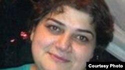 Wartawan Radio Free Europe / Radio Liberty (RFE / RL) Khadija Ismayilova, ditahan dalam rumah tahanan pra-pengadilan selama dua bulan.