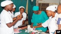 Nigerian midwives receiving obstetrics training.