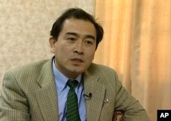 This is an image taken from video taken on April 5, 2004 of Thae Yong Ho, North Korean diplomat speaking during an interview in Pyongyang. North Korea diplomat Thae Yong Ho who was based in London has defected, according to South Korean officials.