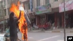 Tibetan Buddhist nun Palden Choetso sets herself ablaze in Daofu, or Tawu in Tibetan, in this still image taken from video shot November 3, 2011.