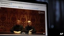 "Founders of Dolce&Gabbana Domenico Dolce, left, and Stefano Gabbana apologize in a video on Chinese social media, saying ""sorry"" in Mandarin seen on a computer screen in Beijing, China, Friday, Nov. 23, 2018."