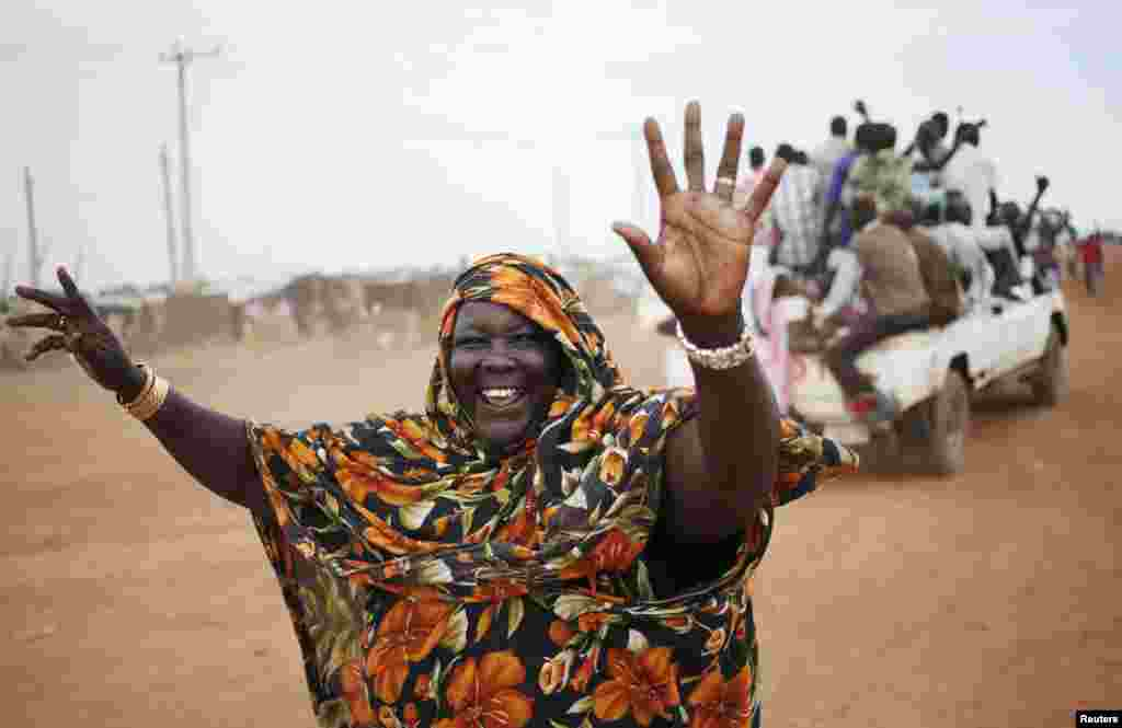 A woman waves to people arriving on vehicles in the town of Abyei ahead of the referendum. Residents of the remote and disputed Abyei border region say they will press on with their own referendum on whether to join Sudan or South Sudan, despite warnings it could trigger violence in the already volatile area.