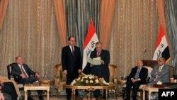 Tổng thống Iraq Jalal Talabani yêu cầu Thủ tướng đương nhiệm Nouri al-Maliki thành lập tân chính phủ, Baghdad, thứ Năm 25/11/2010