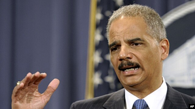 Attorney General Eric Holder gestures during a news conference at the Justice Department in Washington, April 11, 2012.