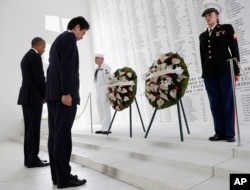 President Barack Obama and Japanese Prime Minister Shinzo Abe participate in a wreath-laying ceremony at the USS Arizona Memorial, part of the World War II Valor in the Pacific National Monument, in Joint Base Pearl Harbor-Hickam, Hawaii, adjacent to Honolulu, Hawaii, Dec. 27, 2016, as part of a ceremony to honor those killed in the Japanese attack on the naval harbor.