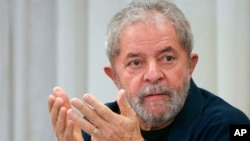 FILE - Brazil's former President Luiz Inacio Lula da Silva attends an extraordinary Worker's Party leaders meeting in Sao Paulo, Brazil, March 30, 2015.