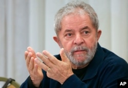 Brazil's former President Luiz Inacio Lula da Silva attends an extraordinary Worker's Party leaders meeting in Sao Paulo, Brazil, March 30, 2015.