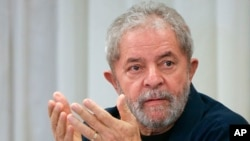 FILE - Brazil's former President Luiz Inacio Lula da Silva attends a meeting in Sao Paulo, Brazil, March 30, 2015.