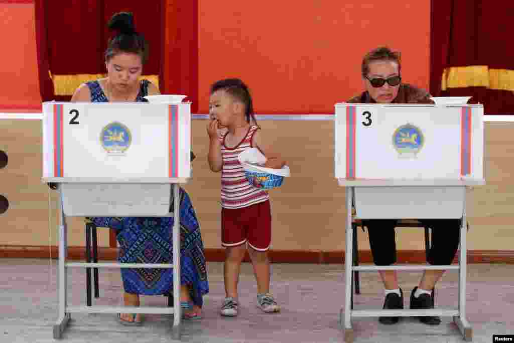 People vote at a polling station in presidential elections in Ulaanbaatar, Mongolia.
