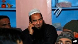 FILE - Kashmiri separatist leader Masarat Alam speaks on a phone at his home in Srinagar, India.