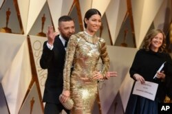 Justin Timberlake, left, and Jessica Biel arrive at the Oscars on Sunday, Feb. 26, 2017, at the Dolby Theatre in Los Angeles.