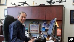 In this May 1, 2017 photo Craig Campbell, the chief executive officer of Alaska Aerospace Corporation, poses for a photo at his office in Anchorage, Alaska.