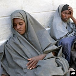 Newly arrived refugees from Barane in Lower Shabelle region in Somalia, rest in the Kenya-Somalia border town of Liboi, July 29, 2011