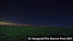 This Jan. 2, 2020, photo shows red lights from wind turbines in the distance in the area of Genoa and Hugo, Colorado, where sightings of unidentified large drones in the air have been reported.
