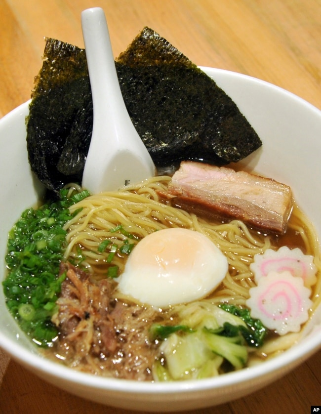 In this Thursday, Nov. 10, 2011 photo, a bowl of Momofuku Ramen, which consists of pork belly, pork shoulder and poached egg, is photographed at David Chang's Momofuku Noodle Bar in New York. (AP Photo/Diane Bondareff)