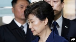 FILE - Ousted South Korean President Park Geun-hye arrives at the Seoul Central District Court for a hearing on a prosecutors' request for her arrest for corruption, in Seoul, South Korea, March 30, 2017.