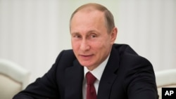 "FILE - Russian President Vladimir Putin, pictured this month at a meeting of the Shanghai Cooperation Organization in Moscow, says Russian influence alone ""is not enough"" to secure peace in Ukraine."