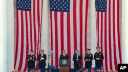 President Barack Obama, center, speaks at a Memorial Day ceremony at Arlington National Cemetery in Arlington, Va., May 25, 2015.