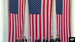 President Barack Obama, center, speaks at a Memorial Day ceremony at Arlington National Cemetery in Arlington, Va., May 25, 2015.
