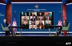 US President-elect Joe Biden (L) and US Vice President-elect Kamala Harris speak virtually with the Covid-19 Advisory Council during a briefing at The Queen theatre on November 9, 2020 in Wilmington, Delaware. (Angela Weiss / AFP)