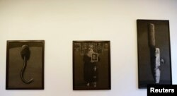 Artworks by Syrian artist Youssef Abdelke are displayed at a gallery in Beirut, Lebanon, Jan. 6, 2014. (Click to enlarge)
