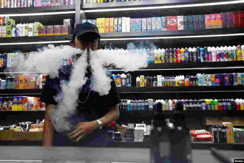An employee vapes at a vape shop in Jakarta, Indonesia.