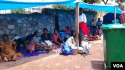 Some of the former workers camping at the GMB headquarters in Harare.
