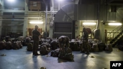 French military packing their bag aboard the French Navy amphibious assault ship BPC Dixmude moored in the port of Douala, Dec. 3, 2013.