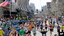 FILE - Runners approach the finish line of the 120th Boston Marathon, in Boston, Massachusetts, April 18, 2016.