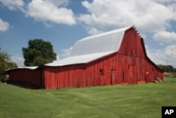 Carol M. Highsmith is photographing wooden barns, which are disappearing across America.