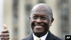 Republican Presidential candidate Herman Cain gestures to the crowd during a campaign stop in Detroit, Michigan (file photo)