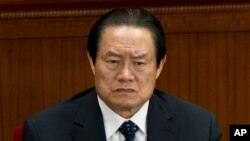 FILE - In this March 11, 2012 file photo, Zhou Yongkang, then Chinese Communist Party Politburo Standing Committee member in charge of security, attends a plenary session of the National People's Congress at the Great Hall of the People in Beijing, China.